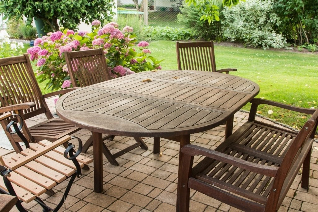 Garden Furniture, wooden oval table with four chairs and a bench