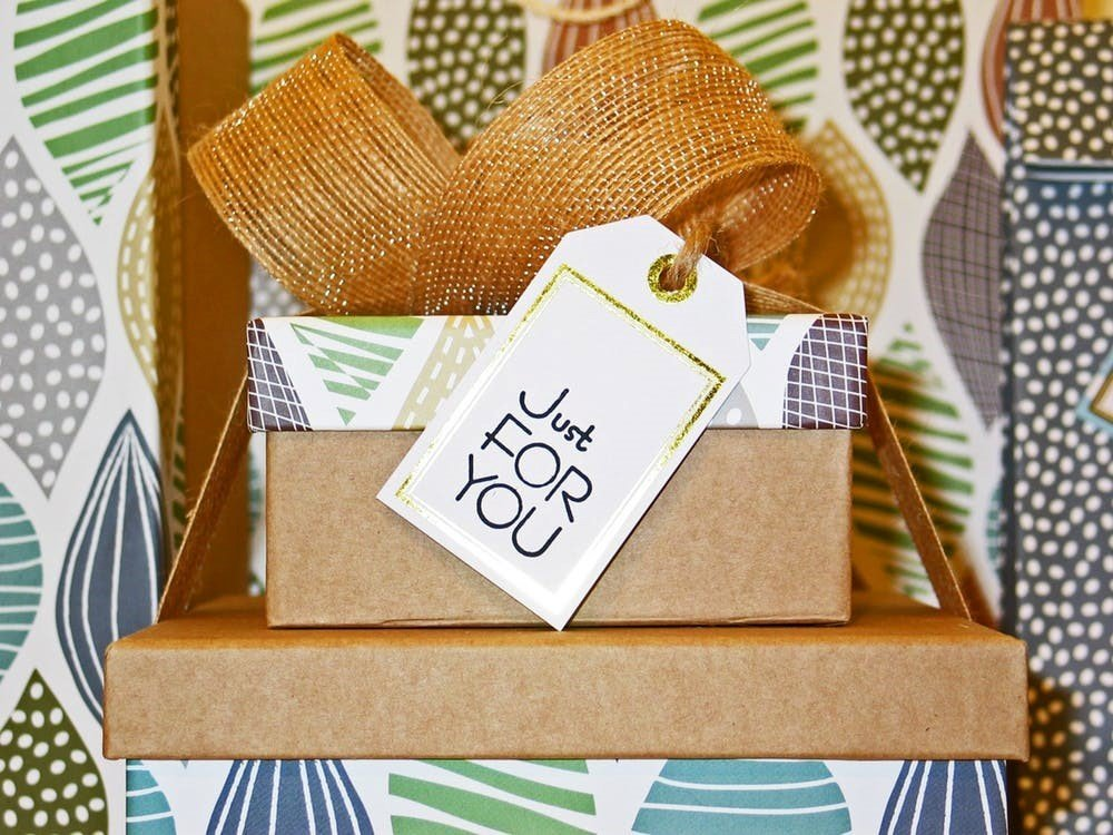 Decorated cardboard boxes with a hessian bow and a lbel saying just for you