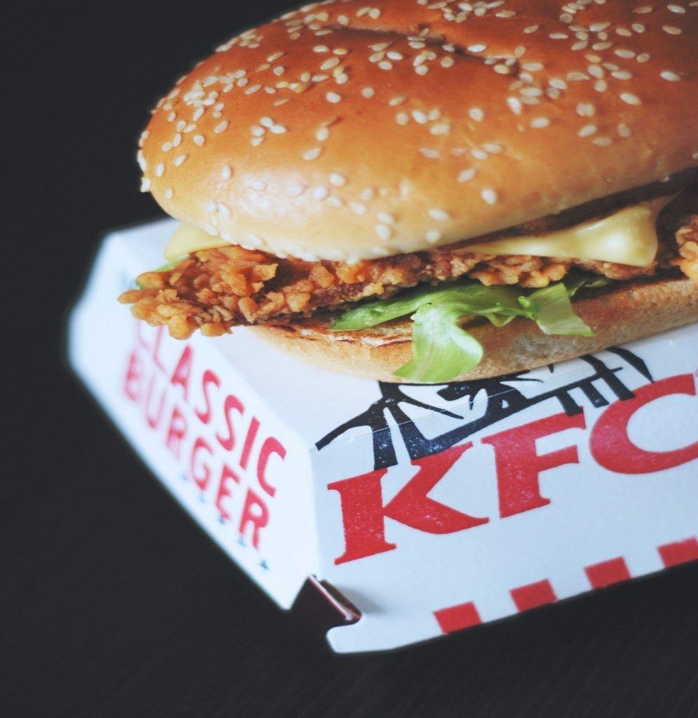 Chicken Burger in Bun resting on a KFC box