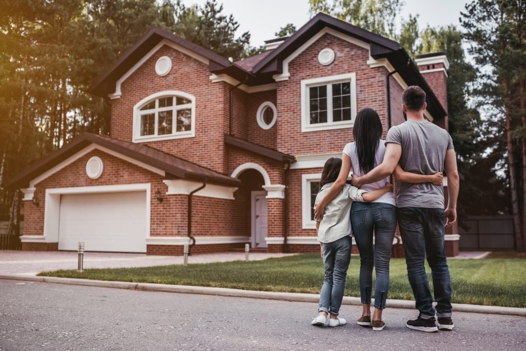 Family stood outside a new house
