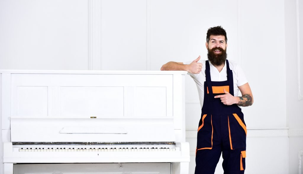 Man giving thumbs up after moving piano